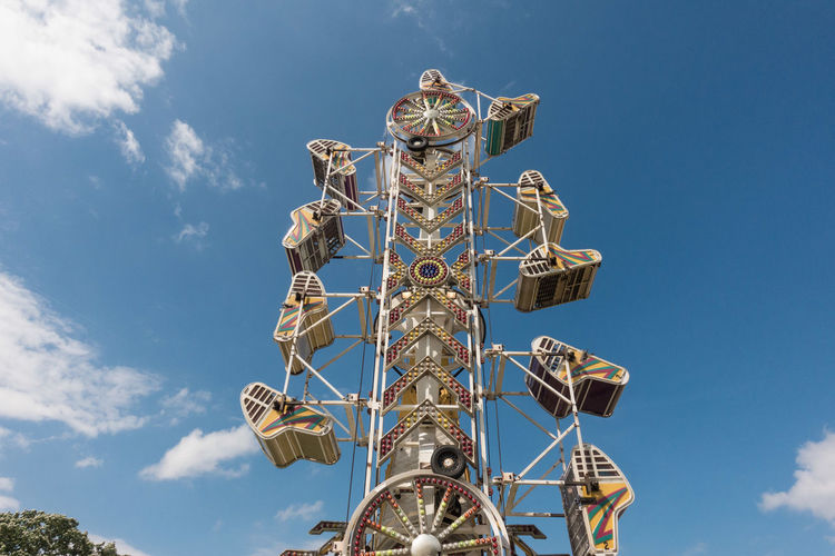 Carnival Amusement Park Ride Blue Cloud - Sky Day Low Angle View No People Outdoors Ride Sky