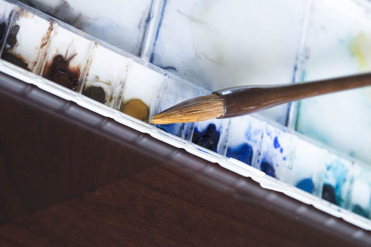 High angle view of paintbrushes on table