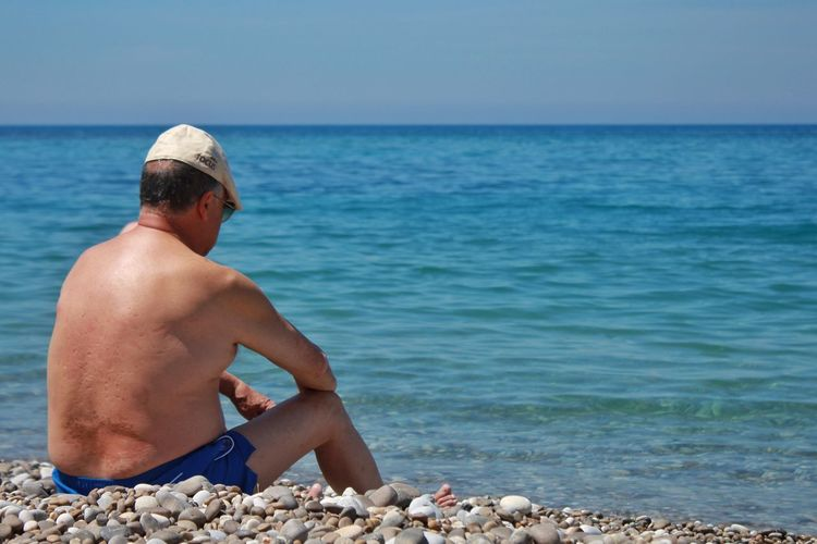 Sea Only Men One Man Only Beach One Person Adults Only Vacations Horizon Over Water Summer Sitting Nature Outdoors Water Shirtless The Photojournalist - 2017 EyeEm Awards Vacations Sun Place Of Heart Live For The Story EyeEmNewHere