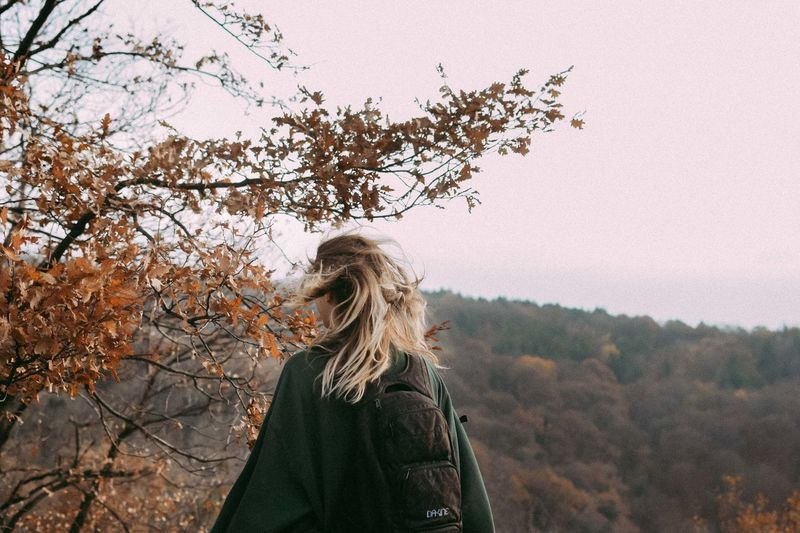 #The Week On EyeEm Autumn Beauty In Nature Blond Hair Branch Clear Sky Close-up Day Focus On Foreground Leisure Activity Lifestyles Nature One Person Outdoors People Real People Rear View Sky Standing Tree Warm Clothing Women Young Adult Young Women