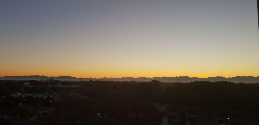 Sunrise This Morning City Cityscape Urban Skyline Sky Silhouette Tranquil Scene Orange Color Mountain Range