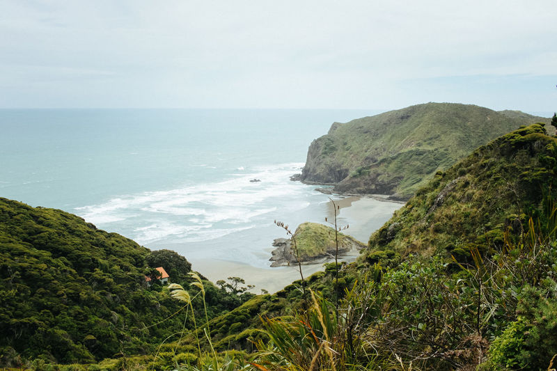 Anawhata Beach, near Auckland, New Zealand Alone Breathtaking Desolate Green Anawhata Beach Beauty In Nature Black Sand Beach Cliff Grass Hill Horizon Over Water Lush Nature New Zealand Ocean Outdoors Rocks Rocks And Water Sand Scenics Sea Tranquility Water Waves