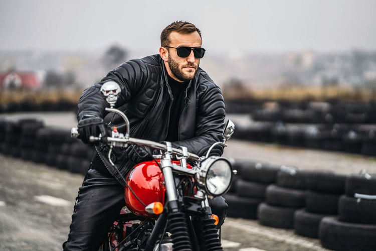 Portrait of young man riding motorcycle