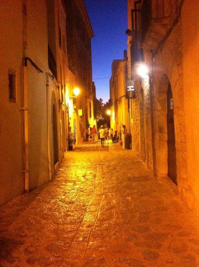 Illuminated Architecture Street Light Street Night Footpath Old Town Old Buildings Little Streets Ibiza Castle Interior Castle Path Pathway Built Structure Arquitecture Arquitetura Colonial Arquitectura Medieval Illuminated Building Exterior Architecture Built Structure Street Light People And Places Night