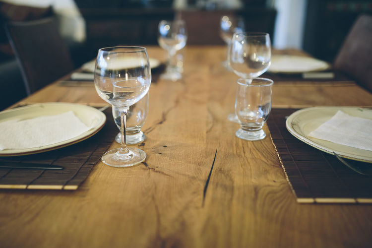 Wooden table with dining set Elegant Set Table Setting Close-up Day Decoration Dining Table Drinking Glass Food And Drink Fork Glass Indoors  Napkin Place Setting Plate Restaurant Style Table Water Wineglass Wood - Material Wooden