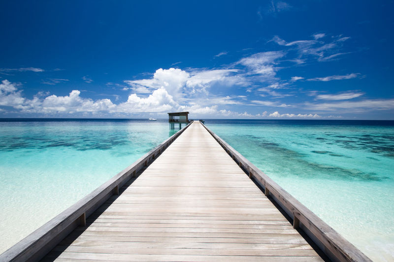 Path to paradise Beauty In Nature Blue Boardwalk Cloud - Sky Diminishing Perspective EyeEm Nature Lover Horizon Over Water Lagoon Long Maldives Nature Ocean Outdoors Pier Scenics Shades Of Blue Sky Summer The Way Forward Tourism Tranquil Scene Tranquility Vacations Water Wood - Material