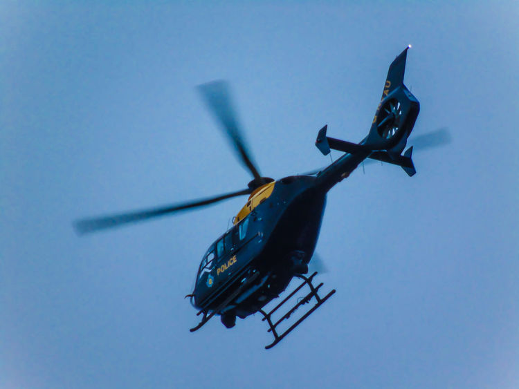 Air Vehicle Blue Clear Sky Close-up Day Flying Helicopter Low Angle View Mode Of Transport Outdoors Sky Technology Transportation Police Police Force Police Helicopter Police