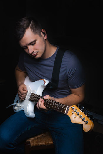 Electric Guitar Wristwatch Casual Clothing Black Background One Person Only Men Arts Culture And Entertainment Lighting Equipment Real People The Portraitist - 2017 EyeEm Awards Indoors  Church Worshipnight BYOPaper! The Portraitist - 2017 EyeEm Awards