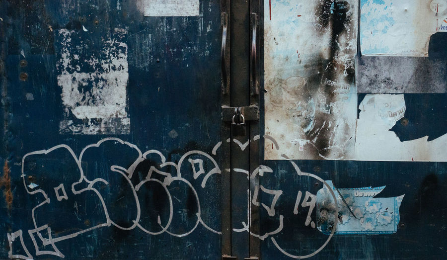 Text Graffiti No People Western Script Weathered Abandoned Old Communication Metal Run-down Deterioration Wall - Building Feature Decline Rusty Door Architecture Entrance Day Art And Craft Close-up Messy