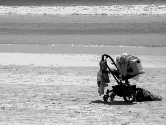 Baby Carriage On Beach