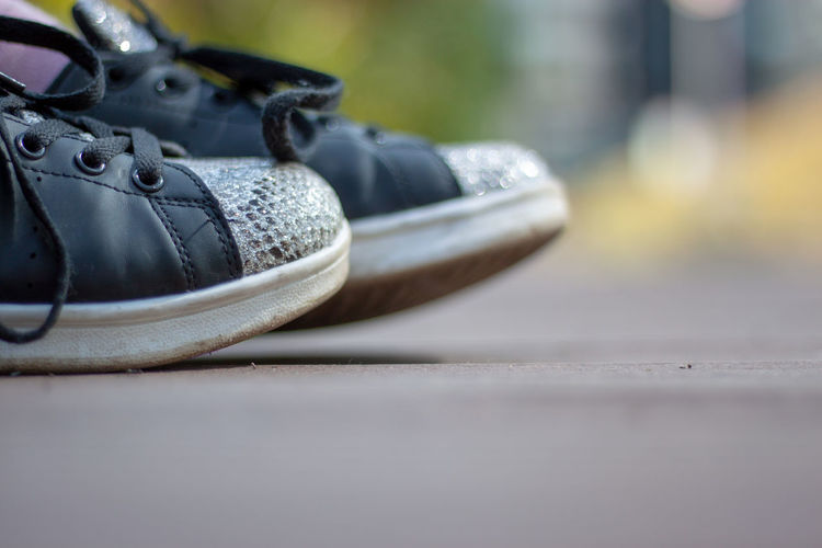 Close-up of shoes on cable car
