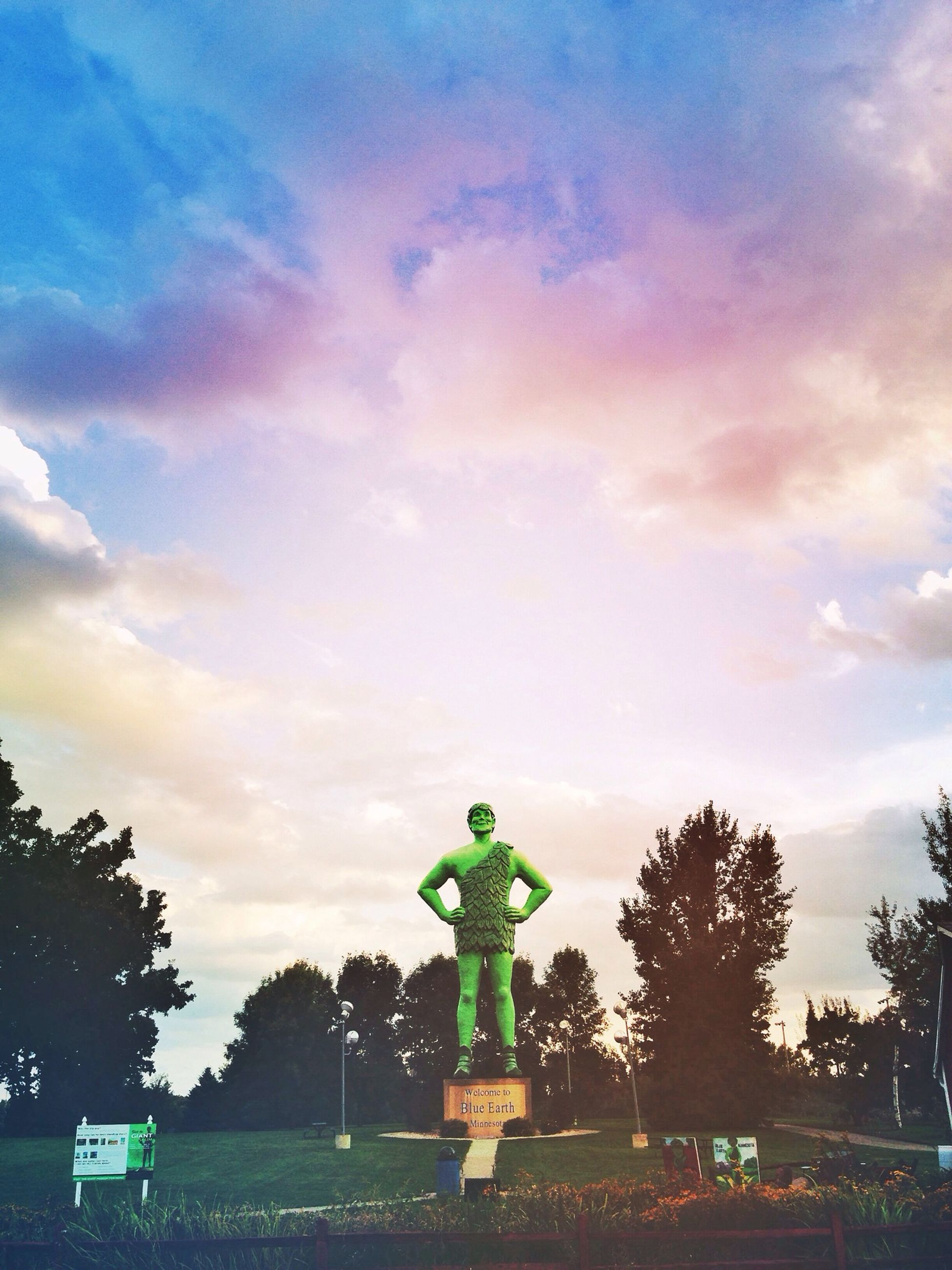 human representation, sky, art, art and craft, statue, sculpture, tree, creativity, cloud - sky, animal representation, cloudy, sunset, dusk, cloud, outdoors, land vehicle, low angle view, no people