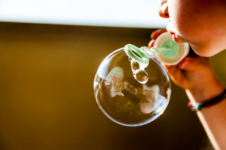 Close-Up Of Hand Holding Bubble Wand