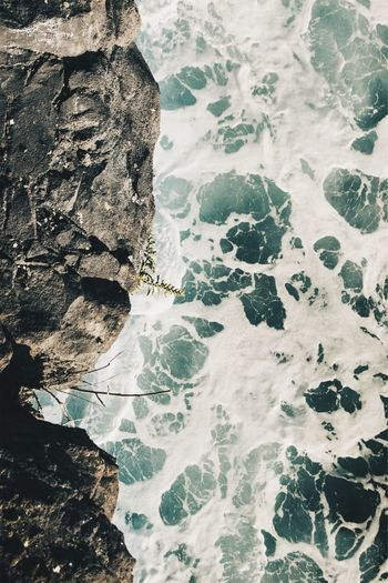 High angle view of rock formation in sea