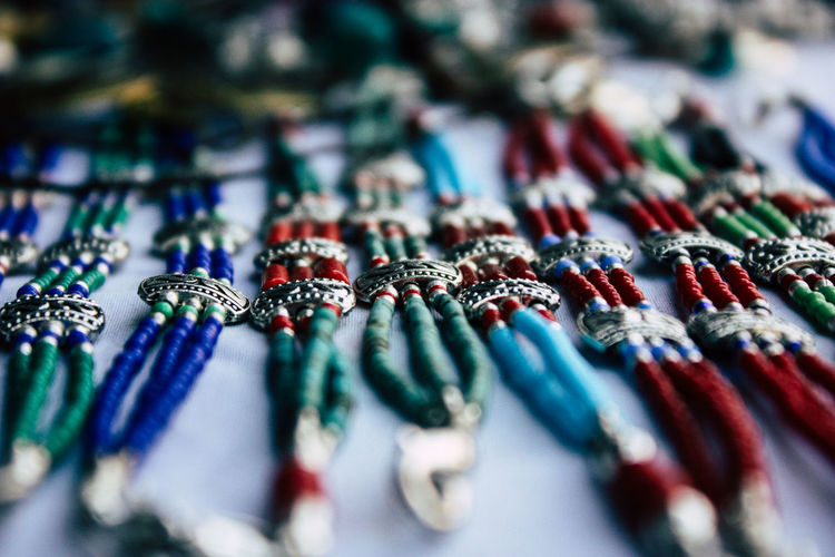 High angle view of multi colored bracelets at market stall