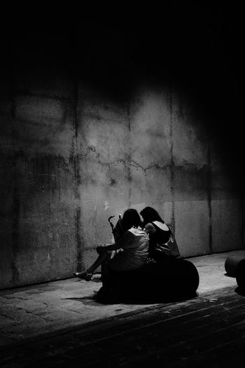2 Women Ambiance Architecture Architecture_collection Dark Deterioration Enlightened Illuminated Lifestyles Mothers Portrait Of A Woman Sitting Sitting Taking Photos The Architect - 2016 EyeEm Awards The Portraitist - 2016 EyeEm Awards The Street Photographer - 2016 EyeEm Awards Waiting The Photojournalist - 2016 EyeEm Awards People Together Monochrome Photography Human Connection