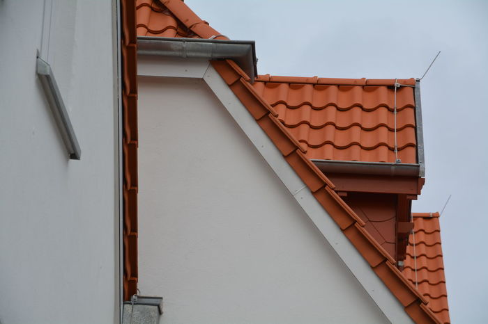 Architecture Balcony Building Building Exterior Built Structure City Clear Sky Day House Low Angle View No People Outdoors Part Of Residential Building Residential Structure Roof Roof Tile Sky Wall - Building Feature Window