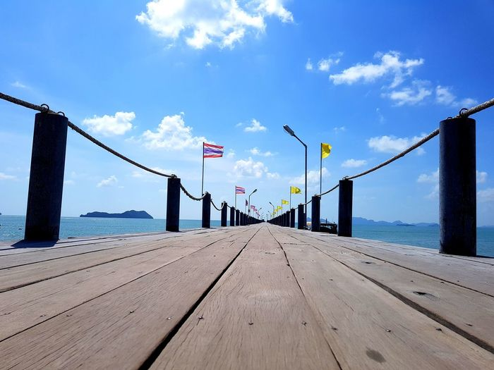 Scenic view of pier on sea against sky