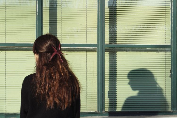 Girl Woman Portrait Shadow Window Architecture Urban Scenics Tranquility Tranquil Scene Travel Destinations Outdoors Day Sunlight Light And Shadow Town City Real People Building Exterior Warm Clothing Winter Human Hand Women Blinds Young Women Standing Window Human Hair Shadow Close-up