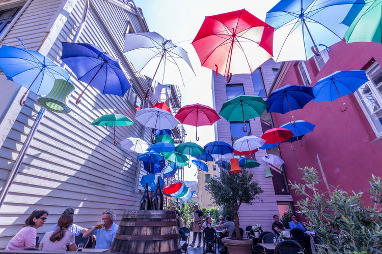 Bergen Norway Scandinavia Streetphotography Crowd Architecture Umbrella Built Structure Lifestyles Leisure Activity Building Exterior Walking Celebration Outdoors Nature Colorful