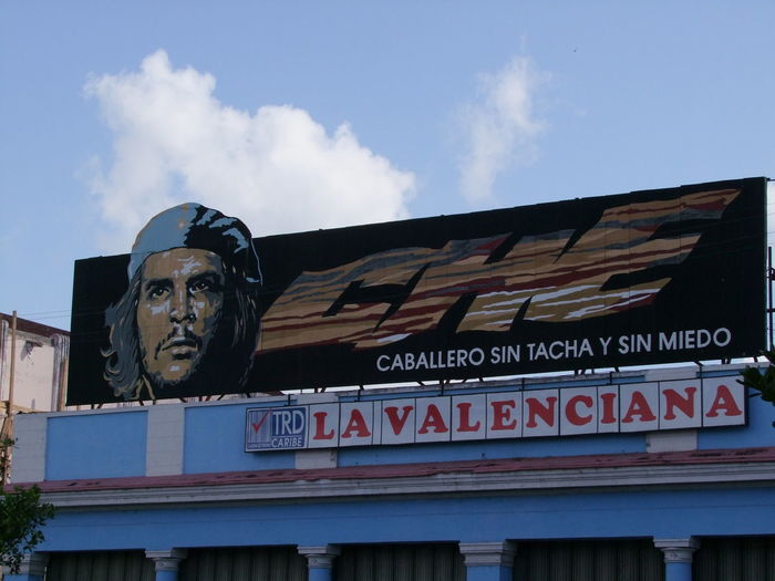 La Valenciana Cinema Signage Blue Sky White Clouds Che Guevara Mural Composition Cuba La Valenciana Signage Building Exterior Che Guevara Cienfuegos Cinema Cinema Sign Cinema Signboard Communication Cuban Style Human Representation Low Angle View Male Likeness No People Outdoor Photography Sign Signage On Building Text Tourism Travel Destination Western Script