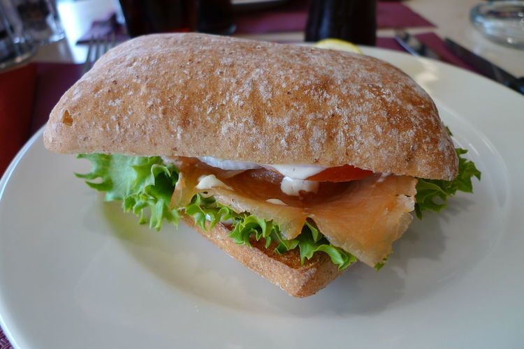 Close-Up Of Sandwich On Plate In Restaurant