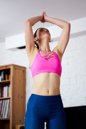 Midsection of woman standing at home