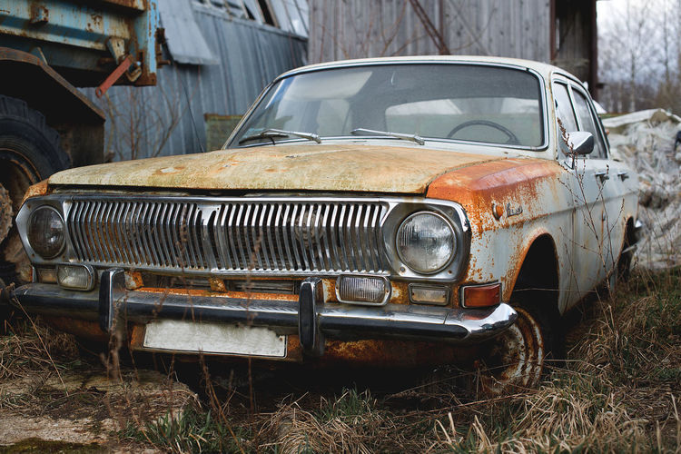 old car Volga Abandoned Bad Condition Car Damaged Day Desolate Destruction Land Vehicle Mode Of Transport No People Obsolete Old Car Vol Old-fashioned Outdoors Rotting Run-down Rusty Soviet Era Transportation Vintage Volga The Secret Spaces