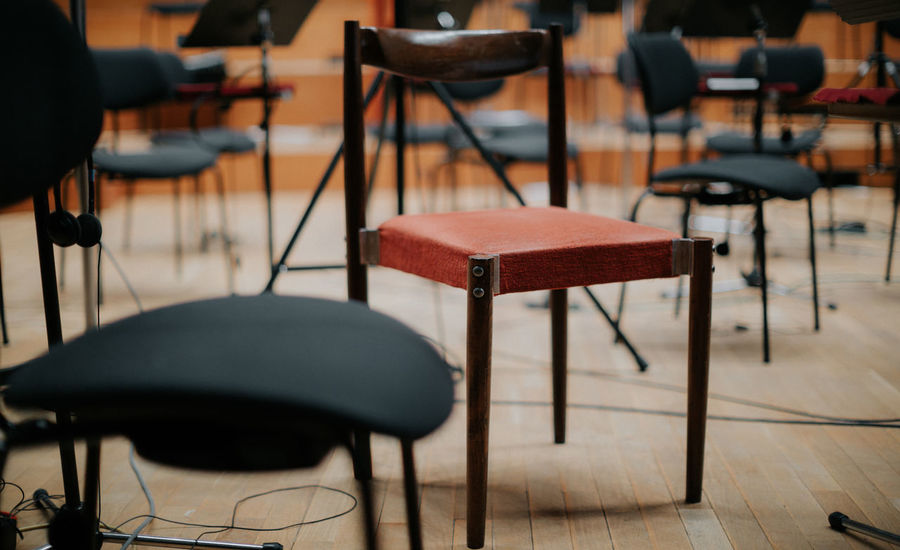Standing out Music Performer  Red Chair Stand Out From The Crowd Symphony Chair Classroom Close-up Concert Concert Hall  Day Desk Education Educational Focus On Foreground Hand Picked Indoors  Music Education No People Orchestra Performance Seat Special Table Wood - Material