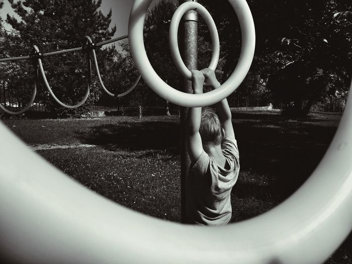 Playground Fun With The Kids Playground Equipment Playground For Kids Training Skills  Hanging Preschool Age Preschool Days Leisure Activity Leisure Time Circles In Circles Outdoor Photography Blackandwhite Photography Monochrome Photography Black & White Daylight Holding On Tight Rope