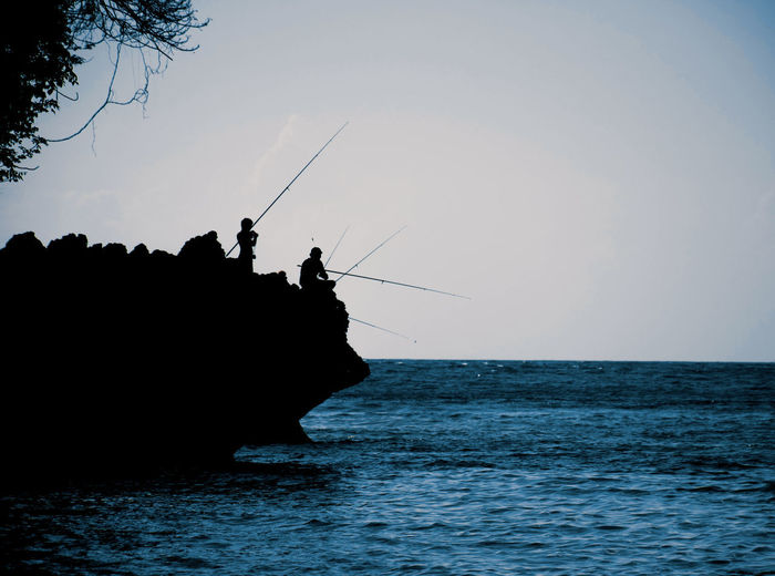 Sky Sea Water Silhouette Nature Waterfront Horizon Horizon Over Water Real People Fishing Rod Scenics - Nature Activity Fishing Beauty In Nature Leisure Activity Rod Clear Sky Tranquility Tranquil Scene Outdoors