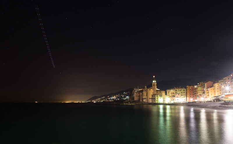 Airplane track at sky above Camogli, Italy 24 Airplane Architecture Astronomy Beauty In Nature Blink Camogli City Illuminated Italia Lights Low Angle View Low Light Nature Night Reflection Sea Silhouette Sky Star - Space Trace Track Water Wide Angle Wonderful