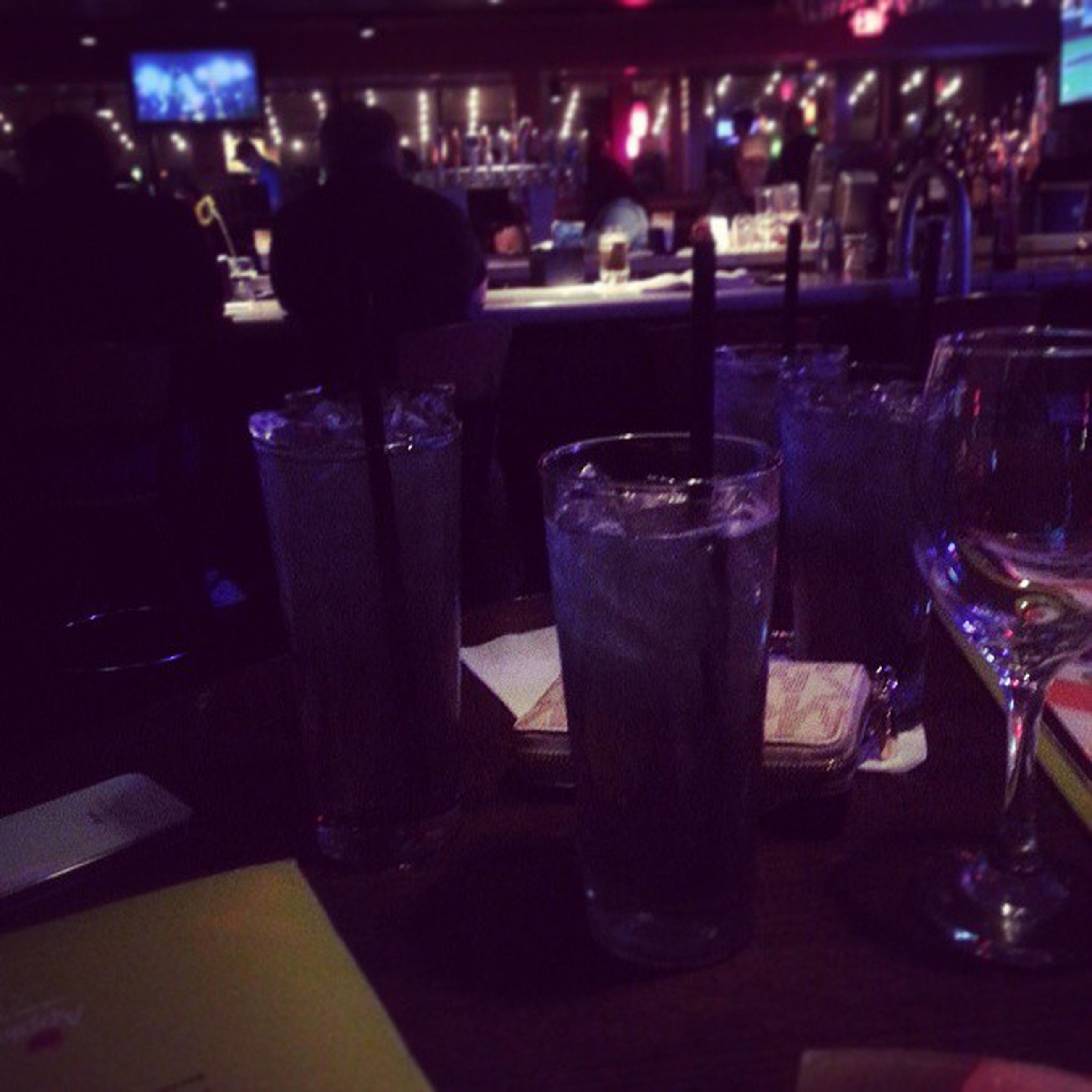 food and drink, indoors, drink, restaurant, table, drinking glass, refreshment, incidental people, freshness, night, alcohol, focus on foreground, glass - material, food, illuminated, wineglass, close-up, lifestyles, still life