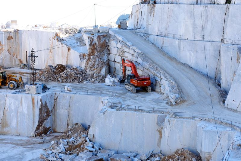 Construction Machinery Transportation Industry Quarry Rubble Outdoors No People Day Sky Carrara Marble Mountains Working Working Place Work