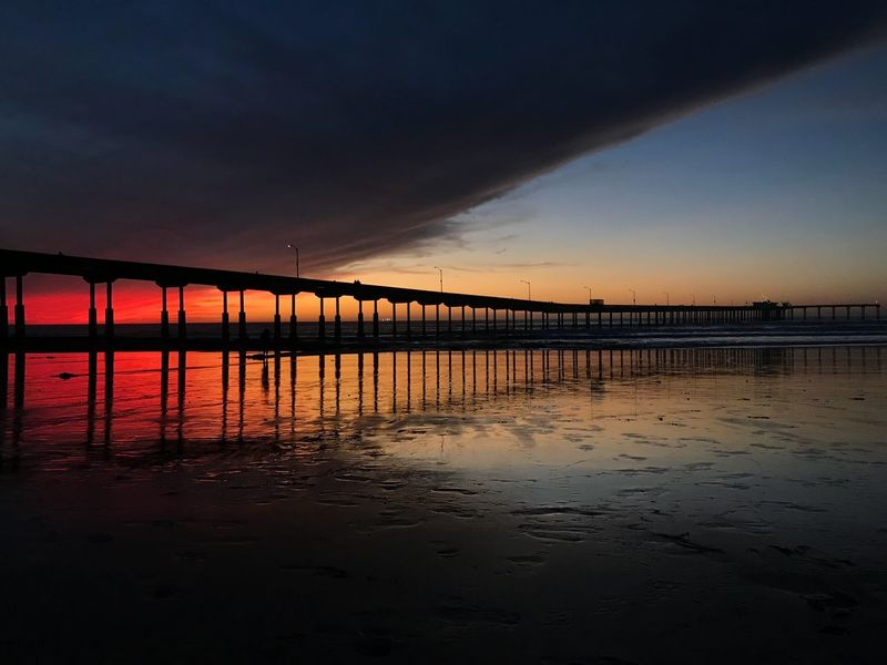 EyeEm Selects Sunset Water Sky Bridge - Man Made Structure Orange Color Nature Cloud - Sky Reflection Scenics Sea Beauty In Nature Beach Outdoors Tranquility Architecture Built Structure Tranquil Scene No People Horizon Over Water Day Dramatic Sky Beachphotography Pier Vacation Destination