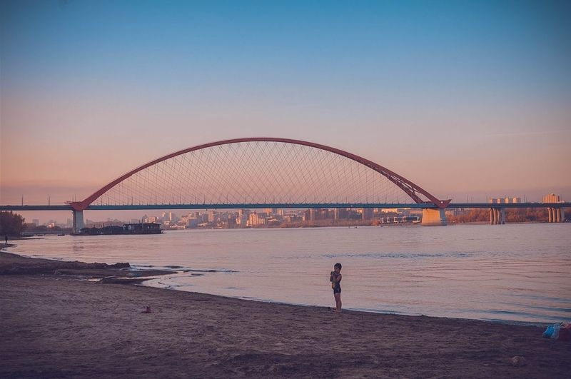 Bridge over bay against clear sky
