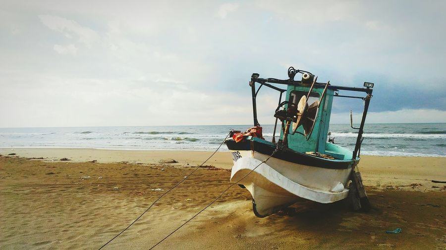 Peschereccio Beach Sea Sand Horizon Over Water Nautical Vessel Beauty In Nature Orange Colour Water Coloradophotographer Multicolours Sunlight Fisherman Boat