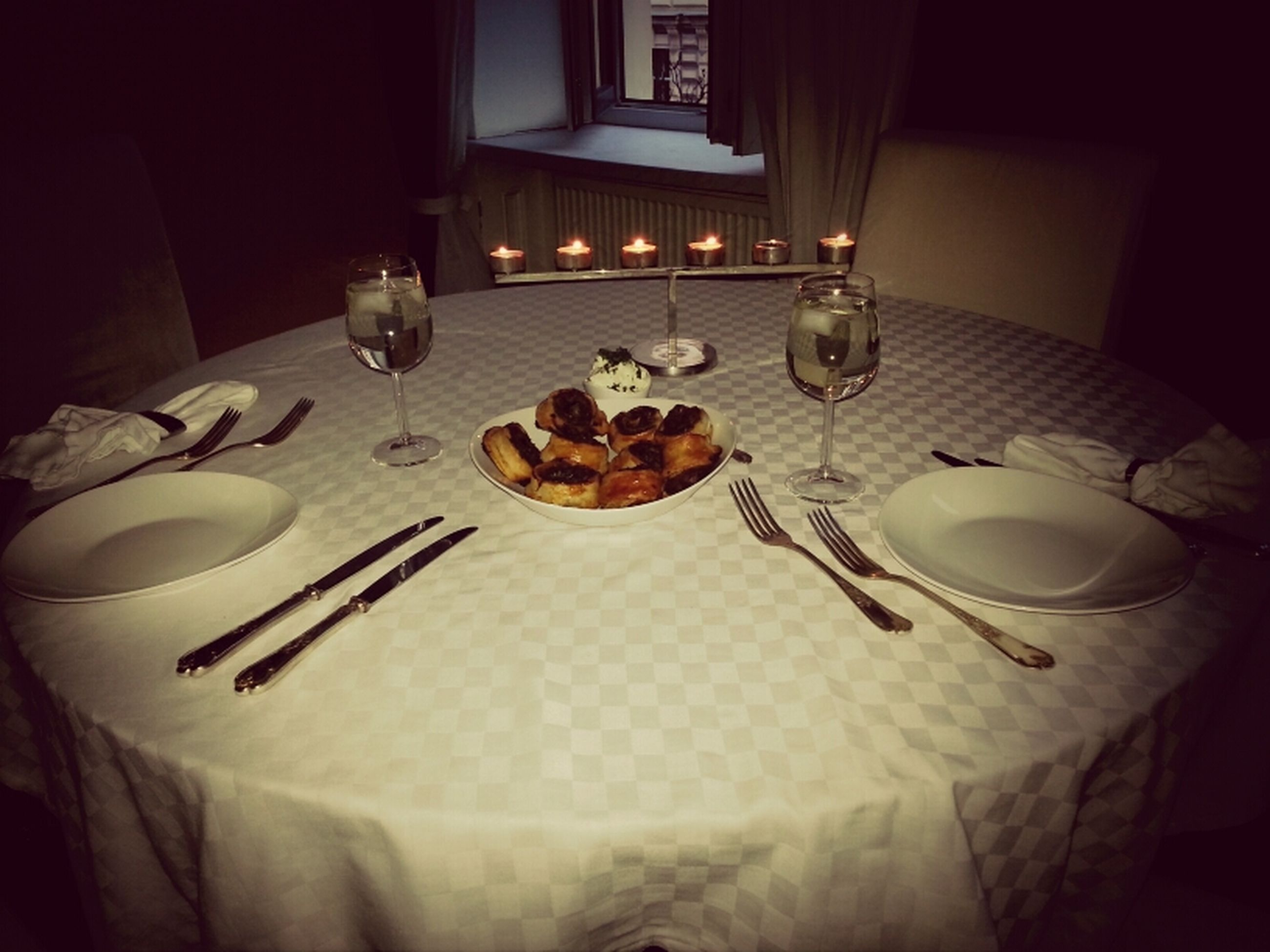 indoors, table, home interior, food and drink, plate, still life, high angle view, food, chair, absence, no people, tablecloth, bed, freshness, ready-to-eat, domestic room, unhealthy eating, sweet food, dining table, home
