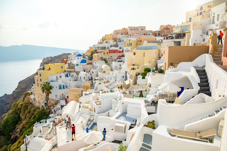 Greece Santorini Oia Thira Water Architecture Sea Building Exterior Built Structure City Sky Nature Day Building High Angle View No People Residential District Beach Island Travel Destinations Town TOWNSCAPE