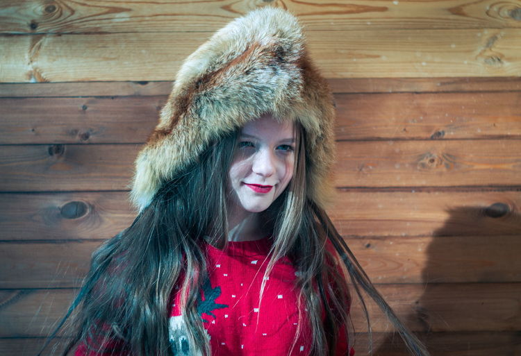 Portrait One Person Smiling Happiness Looking At Camera Clothing Hat Warm Clothing Headshot Hair Front View Winter Wood - Material Women Fur Long Hair Young Adult Emotion Leisure Activity Fur Hat Beautiful Woman Hairstyle Teenager Hood - Clothing