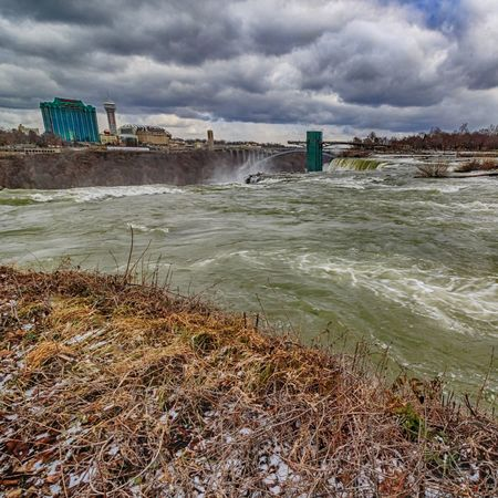 Niagara River and Falls viewed from Luna and Goat Island in Niagara Falls State Park. Cascade Clouds And Sky Cold Weather Falls Goat Island, NY Google HDR High Angle View Mist Misty Niagara Falls Niagara Falls Canada Niagara Falls NY Niagara Falls State Park Park Rain Rainy Day Rapids Rapids River Riverside Site Seeing Tourism Tourist Attraction  Windy Day Winter