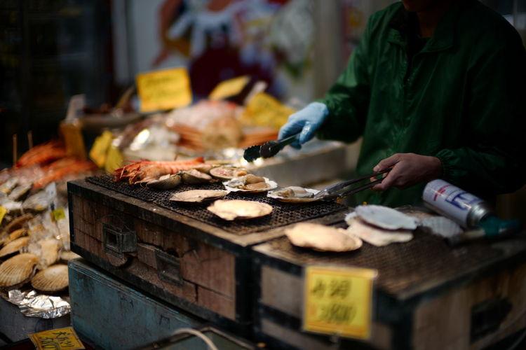 Man preparing food for sale in market