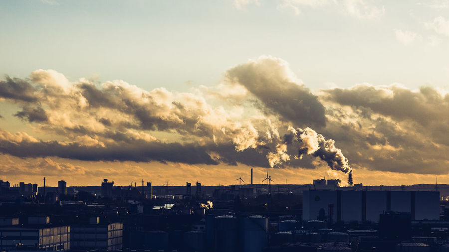 Smoke Emitting From Industry Against Sky During Sunset