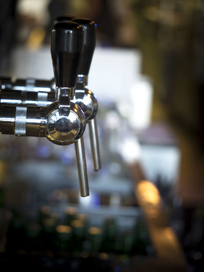 Close-Up Of Beer Taps At Bar