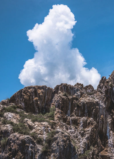 Sky Rock Nature Rock Formation Rock - Object Low Angle View Solid Tranquility No People Tranquil Scene Day Beauty In Nature Environment Mountain Outdoors Scenics - Nature Eroded Cloud - Sky Non-urban Scene Geology Physical Geography Formation Mountain Peak Careyes Cloud