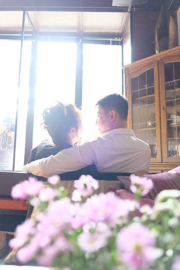 Wedding Photography Adult Bonding Couple - Relationship Day Flower Flowering Plant Indoors  Leisure Activity Lifestyles Love Males  Men Nature People Plant Positive Emotion Real People Togetherness Two People Window Women Young Adult Human Connection Moments Of Happiness