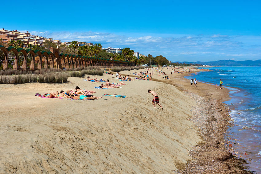 Oropesa del Mar, Spain - March 29, 2016: People sunbathing on the Marina d'Or beach. It is one of Castellon's most developed beach resorts. Spain Beach Castellón Coast Coastline Day Europe Landscape Large Group Of People Marina D'or Oropesa Oropesa Del Mar Outdoors People Sand Scenery Sea SPAIN Spring Sunbathing Sunny Day Suntan Tourist Resort Tourists Travel Destinations Vacations