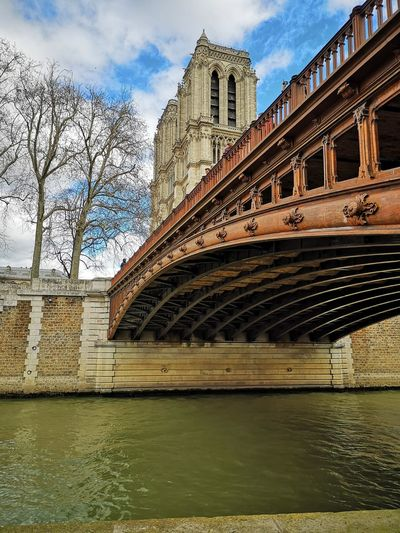 Paris, France  Bridge Historic Bridge Historic Place Pont Au Double Wood Bridge Cathedral Notre Dame De Paris Walk Along The River Church Church Architecture Architecture Perspective City Water Bridge - Man Made Structure River Sky Built Structure Cloud - Sky Building Exterior