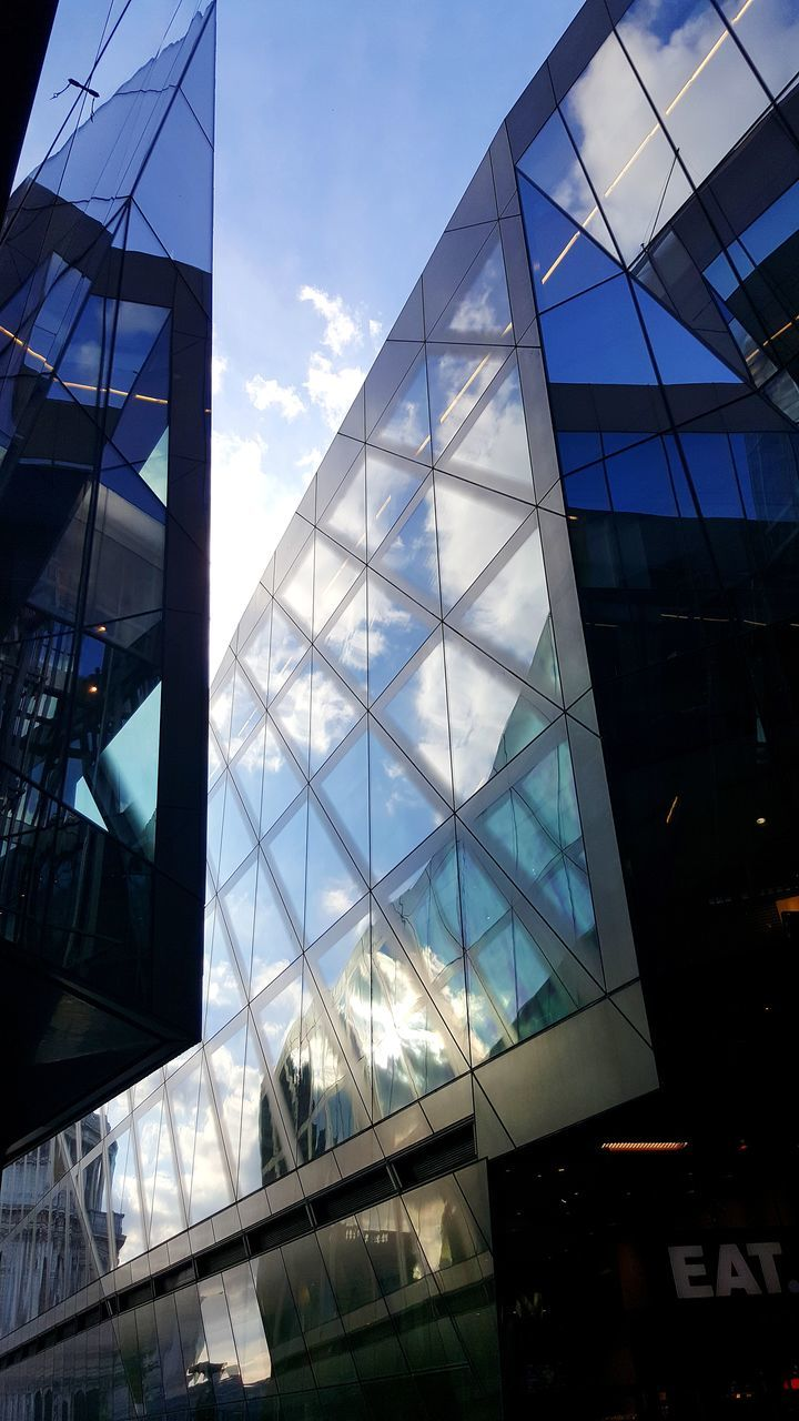 architecture, glass - material, built structure, modern, building exterior, low angle view, reflection, window, skyscraper, day, city, no people, outdoors, sky