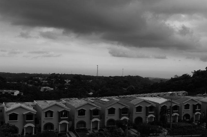 Before the storm. B&w Suburbia Suburban Landscape Dark Outdoors Building Building Exterior Houses Condominium Private Property Clouds